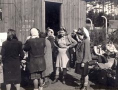 Bergen Belsen, Germany, Female SS guards standing near the entrance to a barrack in the camp, after liberation. The women ss guards were just as inhuman and murderess as the male guards
