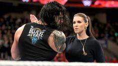 Reigns catches Stephanies slap.