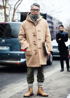 Try teaming a camel duffel coat with charcoal chinos for drinks after work. A pair of tan leather boots will seamlessly integrate within a variety of outfits.  Shop this look for $195:  http://lookastic.com/men/looks/boots-socks-chinos-duffle-coat-scarf/7519  — Tan Leather Boots  — Grey Socks  — Charcoal Chinos  — Camel Duffle Coat  — Charcoal Knit Scarf