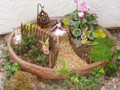 My BFF's fairy garden. She madeit herself! I'm so proud of her, it looks fantastic!