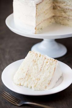 The Most Amazing White Cake is here! It's light, and airy, and absolutely go… The Most Amazing White Cake is here! It's light, and airy, and absolutely gorgeous. This is the white cake you've been dreaming of! Amazing White Cake Recipe, Classic White Wedding Cake Recipe, Light White Cake Recipe, Bakery White Cake Recipe, White Wedding Cake Recipe From Scratch, Vanilla Birthday Cake Recipe, Best Vanilla Cake Recipe, Homemade Vanilla Cake, Moist Vanilla Cake