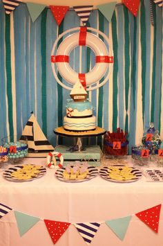 "Nautical Birthday Party table setup.  I'm thinking I could make a paper life saver with ""Happy Birthday Collin"" on it instead of a ship name."