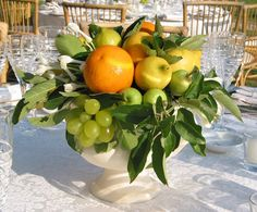 Classic cup with orange, lemon, grapes, stephanotis and greenery.