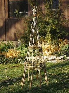 a Bentwood Plant Tepee This twiggy tepee, known in garden circles as a tuteur, guides and supports plants into a decorative pattern.This twiggy tepee, known in garden circles as a tuteur, guides and supports plants into a decorative pattern. Diy Garden, Garden Projects, Garden Art, Garden Plants, Garden Design, Fruit Garden, Wooden Garden, House Plants, Tower Garden