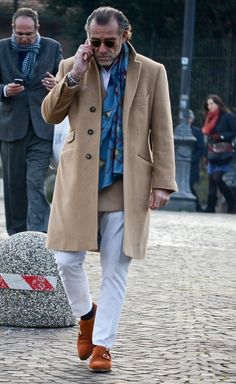 Pitti Day I ... Look at those double monkstrap pieces, coupled with the camel hair overcoat ... Amazing.