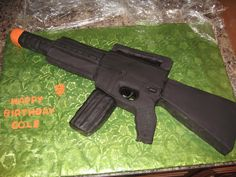 Airsoft gun cake to look like a M16.....all cake except...