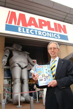 Maplin's Founder, Roger Allen, outside a newly opened Maplin store in Livingstone (Robot Man taking a well earned lean back into the entrance)