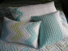 I like this quilting for a zig zag quilt, plus the accent pillows are awesome!.