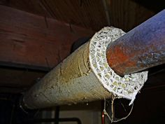 Side shot of asbestos pipe insulation. http://www.jpmoorehomeimprovements.com/Asbestos-Removal.php