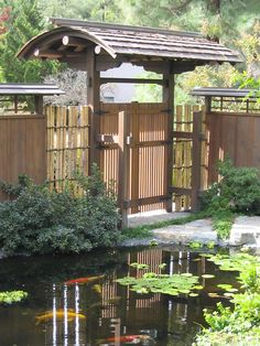 japanese koi ponds | beautiful Japanese Roofed Entry Gate next to a Koi Pond