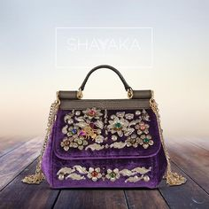Dolce & Gabbana Sicily Top Handle Bag in Purple Velvet and Crystal Embellishments   Size Mini   11 x 15.5 x 9 cm   Available Now   For purchase inquiries, please contact sales@shayyaka.com or +961 71 594 777 (SMS, WhatsApp, or iMessage) or Direct Message on Instagram (@Shayyaka). Guaranteed 100% Authentic   Worldwide Shipping   Bank Transfer or Credit Card