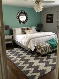 Teal & Grey bedroom.Not a teal wall but a teal blanket across bottom of bed. Love the Chevron patterned gray/white rug