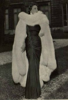 Maggy Rouff, 1949.  Maroon silk jersey gown worn with white fox cape.