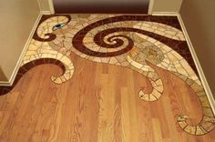 mosaic to wood transition floor. I'd love to do this in our hallway.