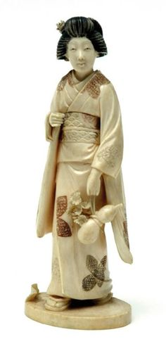 A Japanese ivory figure of a lady, Meiji period, circa 1900. Standing holding a gourd, signed. 7.2 cm high