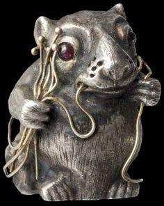 """Fabergé mouse Julius Rappoport, St. Petersburg, circa 1910 Silver, gold and two tourmalines. The Cyrillic mark, """"KF"""" next to a double-headed eagle, """"IP"""", and the St. Petersburg hallmark for """"84"""" zolotniki on the bottom. Height 35 mm. Weight 122 g     : Lot 10"""