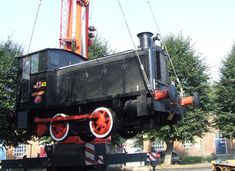 Chatham Dockyard. Andrew Barclay 0-4-0 diesel shunter No. 42 is seen being hoisted by crane onto a low-loader at the Royal Engineers Museum, Gillingham. The locomotive is bound for Chatham Historic Dockyard, where it will form part of a new display. No. 42 was one of a large class of standardised diesel shunters constructed for the War Department during 1941, being dispatched to France as part of the D-Day landings. The name ''Overlord'' is a recent addition, being added during 2000 as part… Chatham Dockyard, D Day Landings, Royal Engineers, Gillingham, Electric Train, Locomotive, Crane, Military Vehicles, Diesel