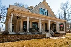 Really like the porch without railings!!! and low shrubs. Another example of the Tucker Bayou.