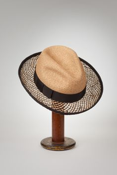 """""""Laurent"""" hat in natural sewn toyo straw crown with novelty black and natural open weave straw brim. Black grosgrain edge and band with tailored bow. Perfect for the polo match or an evening stroll. Jill Courtemanche 