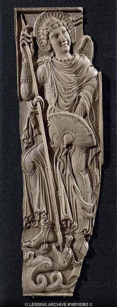 Caroligian ivory bookcover,the Archangel Michael killing the dragon,around 800 Museum des Kunsthandweks-Leipzig Germany