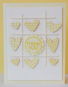 handmade card ... yellow and white ... tick tack toe board lines of bakers twine ... stamped and cut out hearts in the squares ... center spot would be great for a monogram or any other small embellishment ... pretty card!