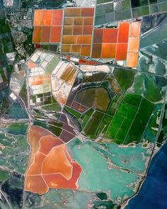 Vibrantly colored salt evaporation ponds are seen adjacent to Port-Saint-Louis-du-Rhône in southern France. Daly City, Canyon Lake, Image Of The Day, Foto Art, West Lake, Surface Design, St Louis, Southern France, Photography