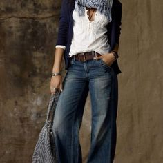 my favorite type of jeans:  wide-leg.  love the belt, too.  the rest of the outfit is pretty feminine to balance out the tomboy jeans