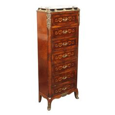 "SEMAINIER - a chest of drawers, usually tall and thin, intended for storing linen and lingerie; it traditionally has seven drawers, one for each day (the name derives from the French word, semaine, meaning ""week""); originating in 18th-century France."