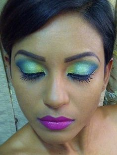 green makeup with violet lips