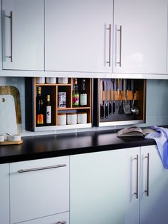 Magnet have just launched a new TV ad campaign and I'm excited to say I've been involved in the online ads, showcasing some of the features of the new kitchen designs. The Magnet Kitchen Cabinet Plus is an innovative design to help you store your smaller items away, which then 'drop down' from a hidden compartment in the wall cabinet. Unique, stylish and modern ... what more could you want from your kitchen?!