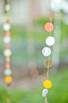 All you need is a one inch paper punch and a sewing machine make this simple but pretty garland.