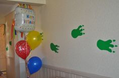 Decorating a Monster-Themed Birthday Party! Monster footprints to lead the guests inside