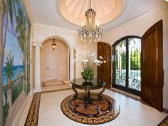 Traditional Entryway with Crown molding, Mural, Uttermost brynmore round table, French doors, Columns, travertine tile floors