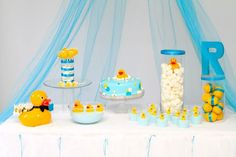 Rubber ducky birthday party theme - white tablecloths with tulle behind