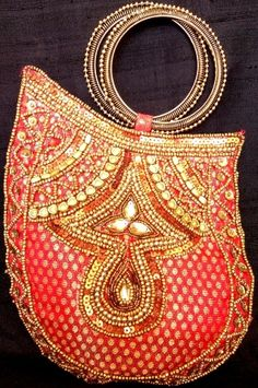 This gorgeous brocade beadwork bangle clutch bag has been handmade by the lady artisans of central India.  - See more at: http://giftpiper.com/Handmade-Beadwork-Brocade-Bangle-Clutch-Red-id-860398.html