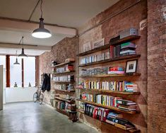 This warehouse conversion was undertaken by Chris Dyson Architects . The resulting home is located in Shoreditch, London , England . Bookshelves In Bedroom, Library Shelves, Book Shelves, Bookcases, Lantern Roof Light, Steel Frame Doors, Decoracion Vintage Chic, Modern Shed, Warehouse Conversion