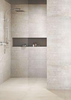 Our handcrafted textured tile range turns simple bathrooms into inspirational ones. Minimal Scandinavian style shower in light grey. #minimaldesign #bathroominspiration #greydecor