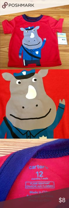 NWT Carter's Sleep Shirt, Size 12 months New With Tags Sleep shirt. Rhino police officer decal on front, solid back. Meant to be a sleep shirt, but doesn't have matching bottoms. Cute as a tee or pair with alternate pajama bottoms. Carter's Shirts & Tops Tees - Short Sleeve