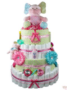 Blooming Elephant Diaper Cake 4 Tier - Our Blooming Elephant Diaper Cake is one 'Ele' of a baby shower gift!  Take a look at the list of ingredients below to see the ton of items that are included with this cake.  Like an elephant, the new parents will never forget this gift! Price:  $298 http://www.rattlecake.com/diaper-cakes/blooming-elephant-diaper-cake-4-tier.html