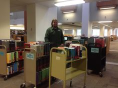 Michael Mitchell surrounded by wild reference books on the move