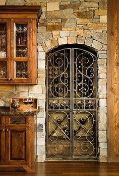 Montana Builders Log Home: Kitchen Stone Wall, Gate Wine Cellar/Rack /OMG beautiful! I need this, for my dream home for sure! Kitchen Stone Wall, Rustic Pantry Door, Pantry Doors, Wine Cellar Racks, Wine Rack, Design Rustique, Home Wine Cellars, Wine Cellar Design, Tuscan Decorating