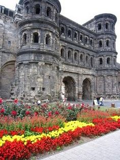 "Trier, Germany - Porta Nigra Gate  ""Thirteen hundred years before Rome, Trier stood / may it stand on and enjoy eternal peace, amen,"" reflects the proud city tradition. Further embroidery in the monkish Gesta made of Trebeta the son of Ninus, a ""King of Assyria"" imagined by the ancient Greeks, by a wife prior to his marriage to the equally non-historical Queen Semiramis."