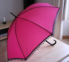 Singing in the Rain Umbrella - Add some whimsy to a rainy day with this Singing in the Rain Umbrella. You can make this easy sewing project by adding some beaded trim to any umbrella. This cute umbrella embellishment also makes for a unique, yet practical gift.