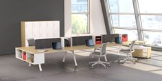Here's another view of what modern, modular workstations can do to perk up your corporate or studio office design. We love the space-saving resource shelving, too. Modern Office Table, Modern Home Office Furniture, Executive Office Furniture, Office Storage Furniture, Office Furniture Design, Office Interior Design, Office Interiors, Office Desk, System Furniture
