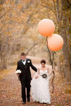 Balloons........how about both of them holding clusters of large balloons, maybe looking up and laughing!