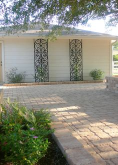 This picture was taken at my patio. The trellis pieces look like iron but are actually custom made from a water resistant composite wood material - faux iron. Faux Iron, Wrought Iron Decor, Iron Trellis, Wrought Iron Fences, Iron Headboard, Iron Decor, Outdoor Decor Backyard, Wrought Iron Trellis, Wrought Iron Wall Decor
