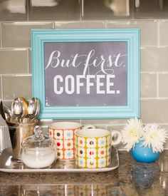 Coffee station. Retro shades of red, turquoise, and yellow, all colors I want to use in my kitchen. Love the mugs.