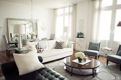 """When Ratia's client first discussed the living-room scheme, her only request was that there be a Mies van der Rohe daybed. Before Ratia could execute a design plan, however, the client not only purchased the daybed, but also a set of six Gustavian dining chairs and a pair of nineteenth-century Italian candelabra sconces. """"I loved all the pieces but they had no relationship to one another design-wise,"""" says Ratia, """"So I had my work cut out for me."""""""