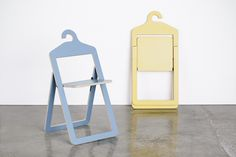 An open marine Umbra Shift Hanger Chair and a folded yellow Hanger Chair that are both designed by Philippe Malouin.