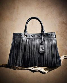 1eb6677ba5e The perfect bag for work and beyond, Lauren Ralph Lauren's Barton Emery  tote features bohemian cross-stitch and fringe details. We're already  imaging how ...